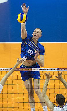France's Kevin Le Roux spikes the ball in the final match France vs Russia of the 2016 Men's Volleyball Olympic Qualification tournament in Berlin January 10, 2016. / AFP / John MACDOUGALL