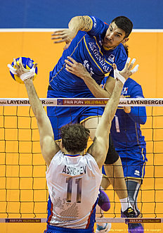 France's Nicolas Le Goff spikes the ball in the final match France vs Russia of the 2016 Men's Volleyball Olympic Qualification tournament in Berlin January 10, 2016. / AFP / John MACDOUGALL
