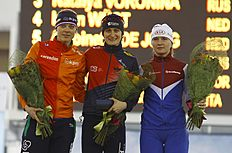 Czech Republic's Martina Sablikova (C), who finished in first place, the Netherlands' Marije Joling (L), in second place and Russia's Natalia Voronona, in third place, pose with their flowers after the women's 5000m ISU European Speed Skating Championships in Minsk, January 10, 2016. REUTERS/Vasily Fedosenko
