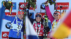(L-R) Second placed Finland's Kaisa Makarainen, winner Italian Dorothea Wierer and third placed Czech Gabriela Soukalova pose during the winner ceremony of the ladies 15 kilometer individual competition at the Biathlon World Cup on January 14, 2016 in Ruhpolding, southern Germany. / AFP / Christof STACHE