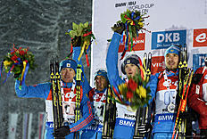 (L-R) Russia's Alexey Volkov, Evgeniy Garanichev, Maxim Tsvetkov and Anton Shipulin pose on the podium during the medal ceremony of the men's 4 x 7,5 km relay competition of the Biathlon World Cup on January 15, 2016 in Ruhpolding, southern Germany.nThe team of Norway won the competition, Russia placed second and Austria placed third. / AFP / Christof STACHE