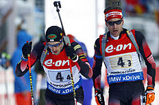 Austria's Simon Eder, right, hands over to Dominik Landertinger during the men's 4x7.5 km relay competition at the Biathlon World Cup in Ruhpolding, Germany, Friday, Jan. 15, 2016. (AP Photo/Matthias Schrader)