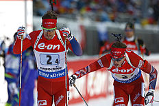 Norway's Tarjei Boe, right, hands over to Emil Hegle Svendsen during the men's 4x7.5 km relay competition at the Biathlon World Cup in Ruhpolding, Germany, Friday, Jan. 15, 2016. (AP Photo/Matthias Schrader)