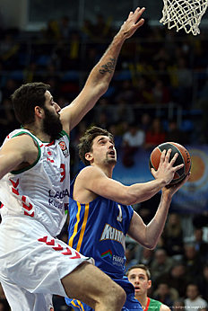 MOSCOW, RUSSIA — JANUARY 15: Alexey Shved, #1 of Khimki Moscow Region competes with Ioannis Bourousis, #9 of Laboral Kutxa Vitoria Gasteiz in action during the Turkish Airlines Euroleague Basketball Top 16 Round 3 game between Khimki Moscow Region v Laboral Kutxa Vitoria Gasteiz at Krylatskoye Arena on January 15, 2016 in Moscow, Russia.