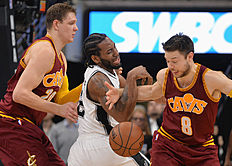 San Antonio Spurs forward Kawhi Leonard, center, tangles with Cleveland Cavaliers guard Matthew Dellavedova, right, and Cavaliers center Timofey Mozgov, of Russia, during the first half of an NBA basketball game Thursday, Jan. 14, 2016, in San Antonio. (AP Photo/Darren Abate)