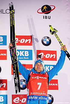 RUHPOLDING, GERMANY — JANUARY 16: Evgeniy Garanichev of Russia celebrates third place celebrate after the Men's 15km Biathlon race of the Ruhpolding IBU Biathlon World Cup on January 16, 2016 in Ruhpolding, Germany.