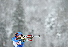Russian Ekaterina Shumilova shoots during the warm up shooting ahead the women's 4 x 6 relay competition at the Biathlon World Cup on January 17, 2016 in Ruhpolding, southern Germany.nThe team of Ukraine won the competition, Germany placed second and Italy placed third. / AFP / Christof STACHE