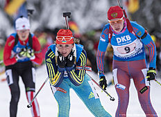 RUHPOLDING, GERMANY — JANUARY 17: Iryna Varvynets of Ukraine, Ekaterina Shumilova of Russia in action during the Women 4 x 5 km relay Biathlon race at the IBU Biathlon World Cup Ruhpolding on January 17, 2016 in Ruhpolding, Germany.