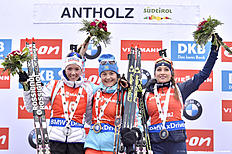 ANTHOLZ-ANTERSELVA, ITALY — JANUARY 23: (FRANCE OUT) Ekaterina Yurlova of Russia (1st place), Selina Gasparin of Switzerland (2nd place), Dorothea Wierer of Italy (3rd place) celebrate on the podium after the IBU Biathlon World Cup Women's Pursuit on January 23, 2016 in Antholz-Anterselva, Italy.