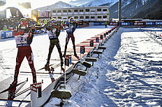 ANTHOLZ-ANTERSELVA, ITALY — JANUARY 24: (FRANCE OUT) Anton Shipulin of Russia takes 1st place, Simon Schempp of Germany takes 2nd place, Erlend Bjoentegaard of Norway takes 3rd place during the IBU Biathlon World Cup Men's and Women's Relay on January 24, 2016 in Antholz-Anterselva, Italy.