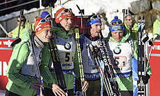 From left, Germany's Simon Schempp, Arnd Peiffer, Benedikt Doll and Erik Lesser celebrate their second place in a Biathlon men's World Cup relay race, in Anterselva, Italy, Sunday, Jan. 24, 2016. (Claudio Onorati/ANSA via AP)