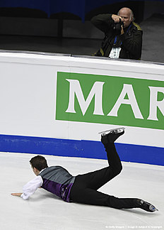 Maxim Kovtun of Russia falls as he competes during men's free skating event during the European Figure Skating Championship in Bratislava on January 28, 2016. / AFP / JOE KLAMAR