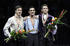 Gold medalist Javier Fernandez of Spain (C), silver medalist Alexei Bychenko of Israel and the bronze medalist Maxim Kovtun (R) of Russia pose at the podium during men's free skating event during the European Figure Skating Championship in Bratislava on January 28, 2016. / AFP / Joe KLAMAR