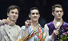 First placed Javier Fernandez of Spain (C) second placed Alexei Bychenko of Israel (L) and third placed Maxim Kovtun of Russia pose on podium of the men's free skating event during the European Figure Skating Championships in Bratislava, on January 28, 2016. / AFP / SAMUEL KUBANI