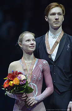 Third placed Evgenia Tarasova and Vladimir Morozov of Russia pose on podium of the pairs free skating event during the European Figure Skating Championships in Bratislava on January 30, 2016. / AFP / SAMUEL KUBANI