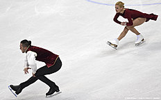 Tatiana Volosozhar (R) and Maxim Trankov (L) of Russia compete during pairs free skating during the European Figure Skating Championship in Bratislava on January 30, 2016. / AFP / JOE KLAMAR