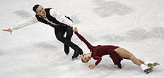 Tatiana Volosozhar and Maxim Trankov of Russia compete during the pairs free skating during the European Figure Skating Championship in Bratislava on January 30, 2016. / AFP / JOE KLAMAR