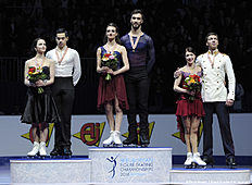(L-R) Second placed Anna Cappellini and Luca Lanotte of Italy, first placed Gabriella Papadakis and Guillaume Cizeron of France and third placed Ekaterina Bobrova and Dmitri Solovjev of Russia pose on the podium after the ice dancing event of the European Figure Skating Championships in Bratislava on January 30, 2016. / AFP / SAMUEL KUBANI