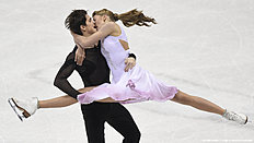 Alexandra Stepanova (R) and Ivan Bukin (L) of Russia compete during ice dance / free dance event during the European Figure Skating Championship in Bratislava on January 30, 2016. / AFP / JOE KLAMAR