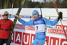 Anton Shipulin of Russia celebrates after finishing second in the men's 10-kilometer sprint at the biathlon World Cup event in Canmore, Alberta, Canada, Thursday, Feb. 4, 2016. (Mike Ridewood/The Canadian Press via AP) MANDATORY CREDIT
