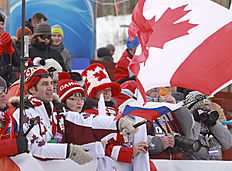 Canadian fans cheer on their team at the finish line of the men's 10-kilometer sprint at the biathlon World Cup event in Canmore, Alberta, Canada, Thursday, Feb. 4, 2016. (Mike Ridewood/The Canadian Press via AP) MANDATORY CREDIT