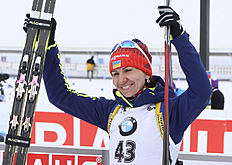 Olena Pidhrushna of Ukraine celebrates her win at the biathlon World Cup event in Canmore, Alberta, Canada, Friday, Feb. 5, 2016. (Mike Ridewood/The Canadian Press via AP) MANDATORY CREDIT