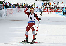 Baiba Bendika of Latvia celebrates in the finish area at the biathlon World Cup event in Canmore, Alberta, Canada, Friday, Feb. 5, 2016. (Mike Ridewood/The Canadian Press via AP) MANDATORY CREDIT