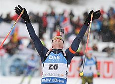 MS04. Canmore (Canada), 06/02/2016.- Dominik Windisch of Italy celebrates his win as he crosses the finish line the Mass Start Men's 15 km event at the World Cup Biathlon in Canmore, Alberta, Canada, 06 February 2016. (Italia) EFE/EPA/MIKE STURK