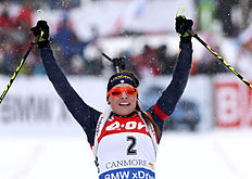 Dorothea Wierer, of Italy, celebrates winning the the women's 12.5-kilometer mass start event at the World Cup biathlon in Canmore, Alberta, Saturday, Feb. 6, 2016. (Mike Ridewood/The Canadian Press via AP) MANDATORY CREDIT