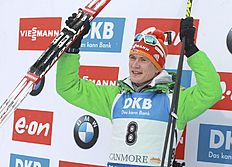 Benedikt Doll, of Germany, celebrates his second place finish in the men's 15-kilometer mass start event at the World Cup biathlon in Canmore, Alberta, Saturday, Feb. 6, 2016. (Mike Ridewood/The Canadian Press via AP) MANDATORY CREDIT