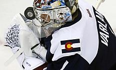 Colorado Avalanche goalie Semyon Varlamov, of Russia, is hit in the mask while trying to make a stop against the Winnipeg Jets in the first period of an NHL hockey game Saturday, Feb. 6, 2016, in Denver. (AP Photo/David Zalubowski)