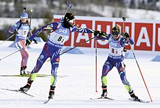 Martin Fourcade, left, and Marie Dorin-Habert, of France, hand off on their way to the win in the single mixed relay at the IBU biathlon World Cup in Canmore, Alberta, Sunday, Feb. 7, 2016. (Mike Ridewood/The Canadian Press via AP) MANDATORY CREDIT