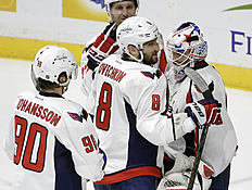 Washington Capitals left wing Alex Ovechkin (8), of Russia, congratulates goalie Braden Holtby, right, after beating the Nashville Predators in an NHL hockey game Tuesday, Feb. 9, 2016, in Nashville, Tenn. At left is forward Marcus Johansson (90), of Sweden. The Capitals won 5-3. (AP Photo/Mark Humphrey)