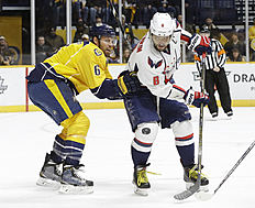 Washington Capitals left wing Alex Ovechkin (8), of Russia, is defended by Nashville Predators' Shea Weber (6) in the first period of an NHL hockey game Tuesday, Feb. 9, 2016, in Nashville, Tenn. (AP Photo/Mark Humphrey)