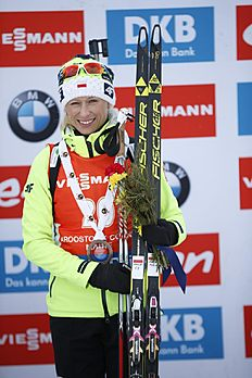 Krystyna Guzik of Poland during flower ceremony after third place finish in the sprint competition during the World Cup Biathlon, Thursday, Feb. 11, 2016, in Presque Isle, Maine. (AP Photo/Robert F. Bukaty)