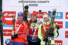 Winner Gabriela Soukalova of the Czech Republic, center, second place finisher Susan Dunklee of Barton, Vermont, left, and third place Krystyna Guzik of Poland pose after the sprint competition during the World Cup Biathlon, Thursday, Feb. 11, 2016, in Presque Isle, Maine. (AP Photo/Robert F. Bukaty)