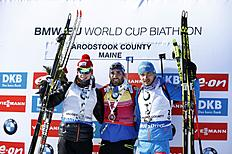 Winner Martin Fourcade of France, center, shares the podium with second place finisher Johannes Thingnes Boe of Norway, left, and Anton Shipulin of Russia, after the 12.5 km pursuit competition during the World Cup Biathlon, Friday, Feb. 12, 2016, in Presque Isle, Maine. (AP Photo/Robert F. Bukaty)
