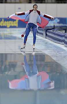 Denis Yuskov, of Russia, skates his victory lap after winning the men's 1500 meter race of the speedskating single distance World Championships in Kolomna, Russia, on Friday, Feb. 12, 2016. (AP Photo/Ivan Sekretarev)