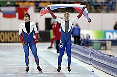 Russia's winner Pavel Kulizhnikov, right, reacts as silver medalist Ruslan Murashov skates after the men's 500 meter race of the speedskating single distance World Championships in Kolomna, Russia, on Sunday, Feb. 14, 2016. (AP Photo/Ivan Sekretarev)
