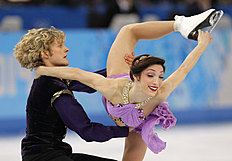 FILE � In this Feb. 27, 2014, file photo, Meryl Davis and Charlie White, of the United States, compete in the ice dance free dance figure skating finals at the Iceberg Skating Palace during the 2014 Winter Olympics in Sochi, Russia. The Olympic ice dance champions will be honored, along with actress Cicely Tyson, in April by Figure Skating in Harlem. (AP Photo/Vadim Ghirda, File)