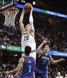 Cleveland Cavaliers' Timofey Mozgov (20), from Russia, drives to the basket against Charlotte Hornetsu00e2u0080u0099 Courtney Lee (1) and Jeremy Lin (7) in the first half of an NBA basketball game Wednesday, Feb. 24, 2016, in Cleveland. (AP Photo/Tony Dejak)