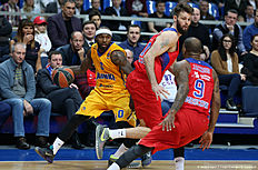 MOSCOW, RUSSIA — FEBRUARY 25: Tyrese Rice, #0 of Khimki Moscow Region competes with Aaron Jackson, #9 and Joel Freeland, #19 of CSKA Moscow in action during the 2015-2016 Turkish Airlines Euroleague Basketball Top 16 Round 8 game between CSKA Moscow v Khimki Moscow Region at Megasport Arena on February 25, 2016 in Moscow, Russia.