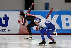 Russia's Pavel Kulizhnikov, front, skates against Canada's Laurent Dubreuil to win the men's 500-meter race of the World Sprint Speed Skating Championships in Seoul, South Korea, Saturday, Feb. 27, 2016. (AP Photo/Lee Jin-man)