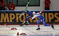 Ronald Mulder, left, of the Netherlands and Ruslan Murashov of Russia cross the finish line during the men's 500-meter race of the World Sprint Speed Skating Championships in Seoul, South Korea, Saturday, Feb. 27, 2016. (AP Photo/Lee Jin-man)