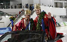 Gold medalists Brittany Bowe of the United States, left, and Pavel Kulizhnikov of Russia pose on the car during a parade after awarding ceremony for the ISU World Sprint Speed Skating Championships in Seoul, South Korea, Sunday, Feb. 28, 2016. (AP Photo/Lee Jin-man)