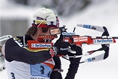 Michael Roesch, of Germany, fires his rifle during the IBU Biathlon World Cup Men's 4x7.5 KM Relay skiing event at the Whistler Olympic Park in Whistler, British Columbia, Sunday, March 15, 2009.