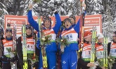 From left to right, France's Vincent Defrasne and Martin Fourcade; Sweden's David Ekholm, Fredrik Lindstroem, Carl Johan Bergman and Mattias Nillson; and Germany's Simon Schempp, Daniel Boehm and Michael Roesch celebrate atop the podium after the IBU Biathlon World Cup Men's 4x7.5 KM Relay skiing event at the Whistler Olympic Park in Whistler, British Columbia, Sunday, March 15, 2009. Sweden finished first, France finished second and Germany finished third.