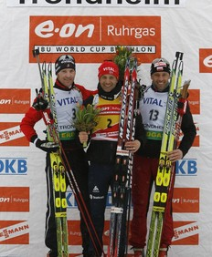 First placed Norway's Ole Einar Bjoerndalen (C), second placed Austria's Simon Eder (L) and third placed Poland's Tomasz Sikora celebrate on the podium after the IBU Biathlon World Cup men's 12.5 km pursuit competition in Tronhdeim March 21, 2009.
