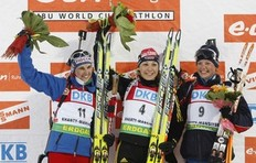 First place finisher Magdalena Neuner of Germany (C) celebrates with second placed Michela Ponza of Italy (L) and third placed Marie Dorin of France after the women's 10 km pursuit at the Biathlon World Cup Final in the Siberian town of Khanty-Mansiysk, 2, 000 km (1, 243 miles) east of Moscow, March 28, 2009.