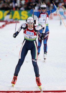 Michela Ponza of Italy crosses the finish line to take second place during the women's 10 km pursuit at the Biathlon World Cup Final in the Siberian town of Khanty-Mansiysk, 2, 000 km (1, 243 miles) east of Moscow, March 28, 2009.